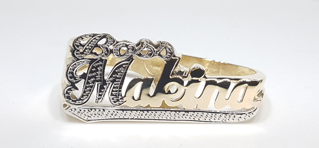 Custom made Boss Makina two finger name ring in 14 karat yellow gold two tone with high polish and white bead work