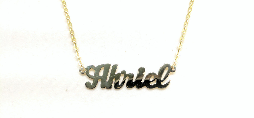 In the center: a custom made name plate rolo necklace for Ahriel in script 14 karat yellow gold and high polish finish by Popular Jewelry