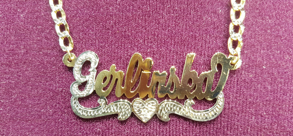 In the center: a custom made name plate cuban necklace for Gerlinska in 14 karat two tone yellow gold with high polish finish and white bead work and heart shaped tail made by Popular Jewelry