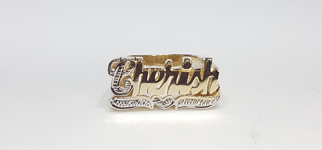 In the center: a custom made name ring Cherish in 14 karat yellow gold two tone white bead work cut finish - Popular Jewelry