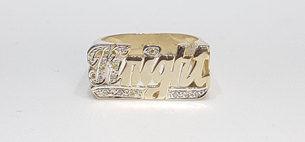 In the center: a custom made name ring Knight in 14 karat yellow gold set with pink and yellow stones - Popular Jewelry