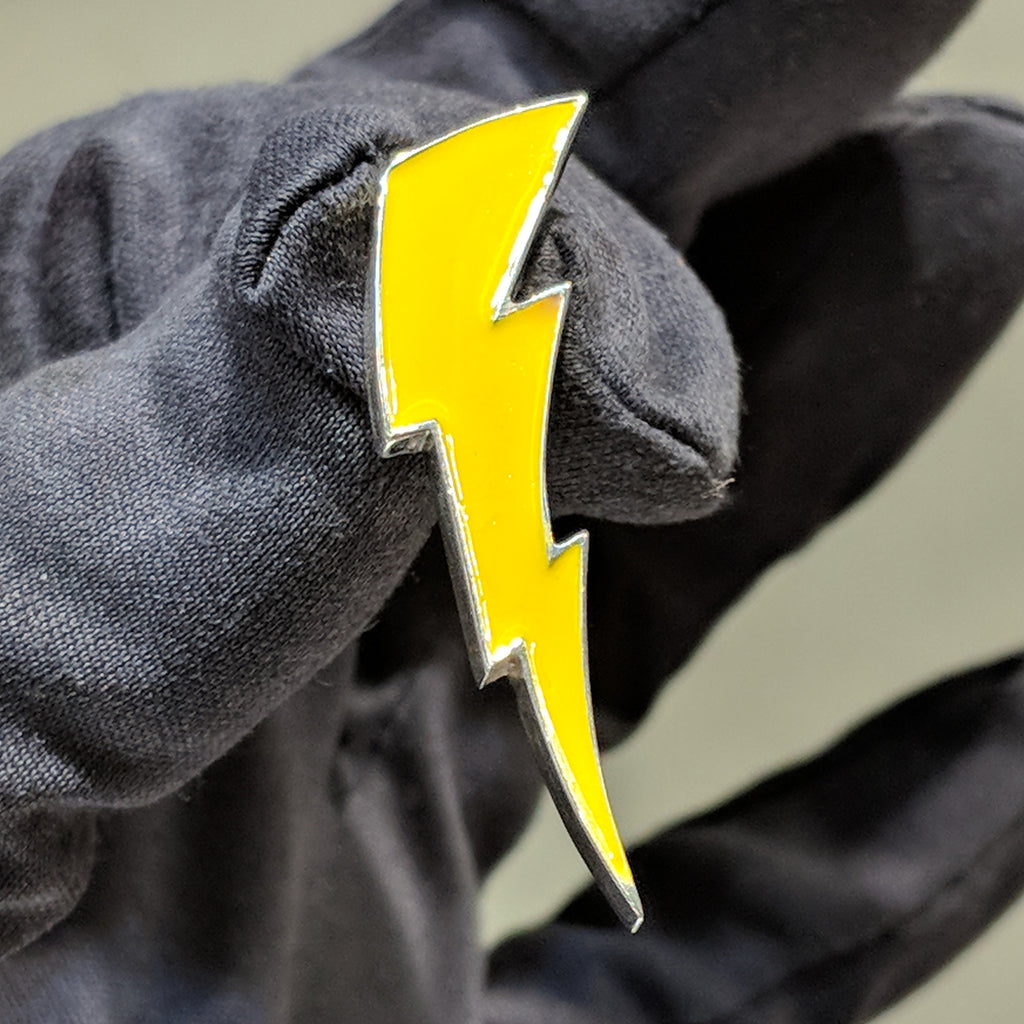 A customized lightning bolt pendant made for our client Zaire. The pendant is colored via usage of soft enamel.