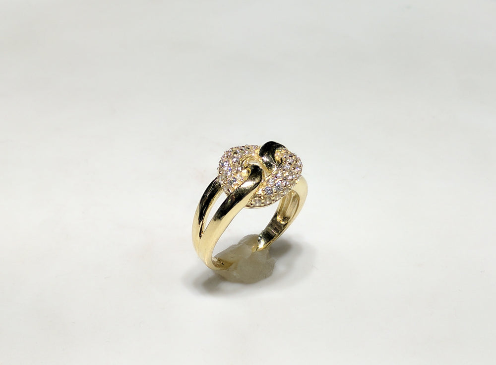 In the center: 10 karat yellow gold lady's puffy round link ring set with cubic zirconia in micro pave setting standing up facing the viewer at an angle made by Popular Jewelry