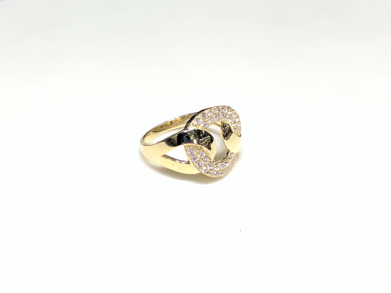 In the center: a 10 karat yellow gold lady's ring in the shape of a flat round link set with cubic zirconia in a micro pave setting laying on its side facing vieweran angle made by Popular Jewelry in New York City