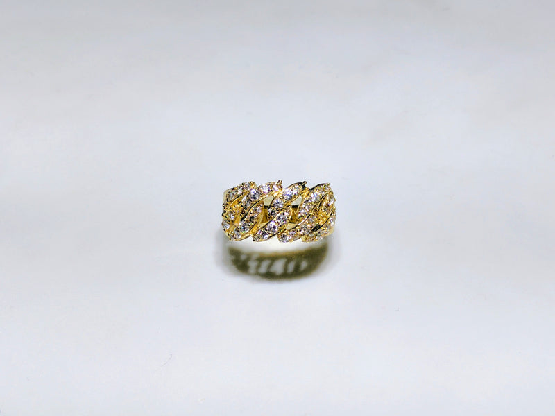 In the center: a 10 karat yellow gold wide cuban link ring iced out with pave set cubic zirconia standing up bird's eye view made by Popular Jewelry