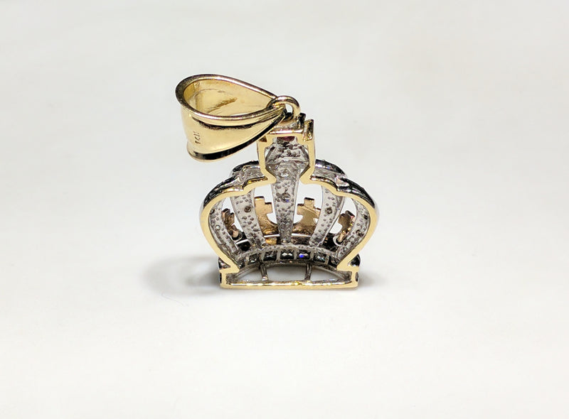 In the center: a 14K rose, white, and yellow gold king's crown pendant set with round and princess cut cubic zirconia standing rear view stamp made by Popular Jewelry