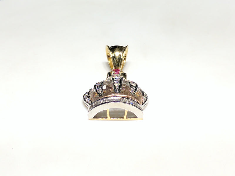 In the center: a 14K rose, white, and yellow gold king's crown pendant set with round and princess cut cubic zirconia laying flat front view made by Popular Jewelry