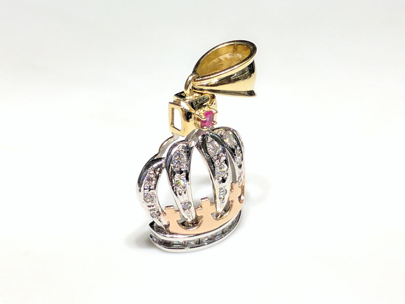In the center: a 14K rose, white, and yellow gold king's crown pendant set with round and princess cut cubic zirconia standing angle view made by Popular Jewelry
