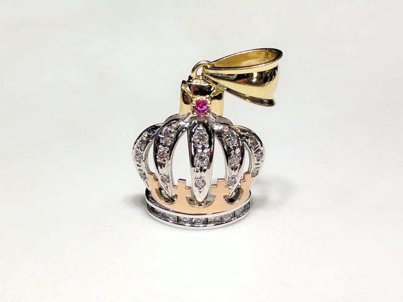 In the center: a 14K rose, white, and yellow gold king's crown pendant set with round and princess cut cubic zirconia standing front view made by Popular Jewelry