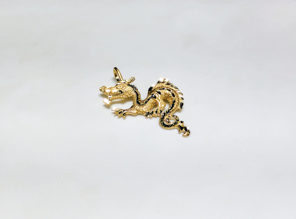 In the center: a 14 karat yellow gold diamond cut eastern asian dragon laying flat in angle view - Popular Jewelry