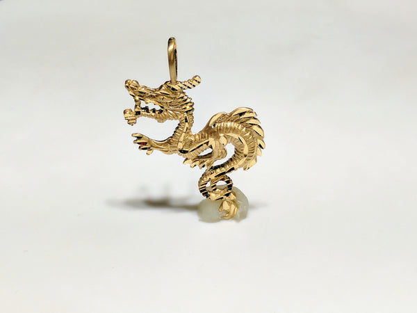 In the center: a 14 karat yellow gold diamond cut eastern asian dragon standing in frontal view - Popular Jewelry