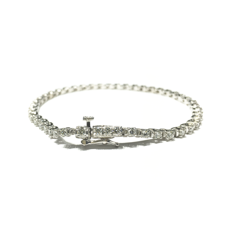products/585_14_karat_White_Gold_Round_Diamond_Tennis_Four-Prong_Bracelet_lock_angle_view_web_product_Popular_Jewelry_New_York.png