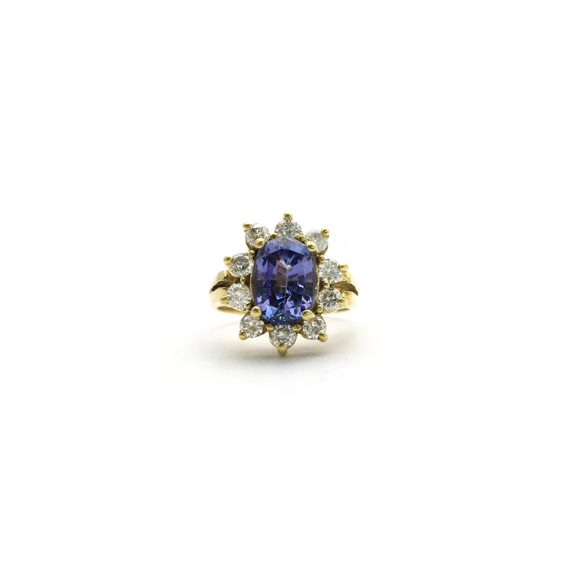 products/750_18_Karat_Yellow_Gold_Oval_Tanzanite_Diamond_Sunburst_Halo_Ring_Front_Angle_View_Web_Product_Popular_Jewelry_New_York.jpg