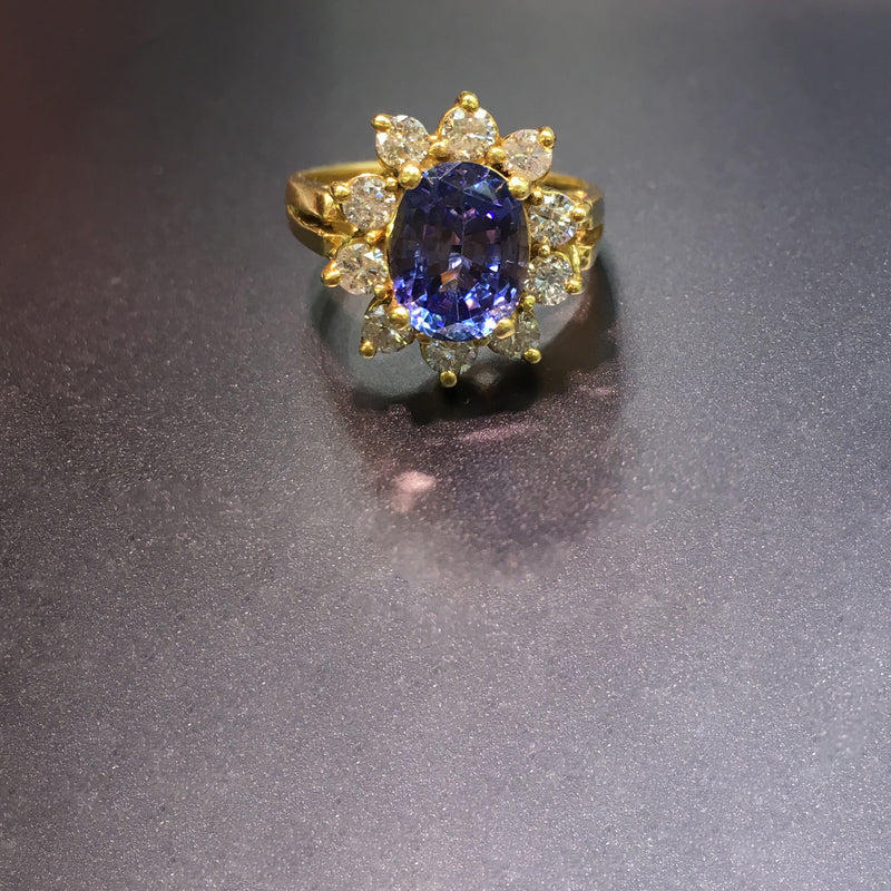 products/750_18_Karat_Yellow_Gold_Oval_Tanzanite_Diamond_Sunburst_Halo_Ring_Live_View_Web_Product_Popular_Jewelry_New_York.jpg