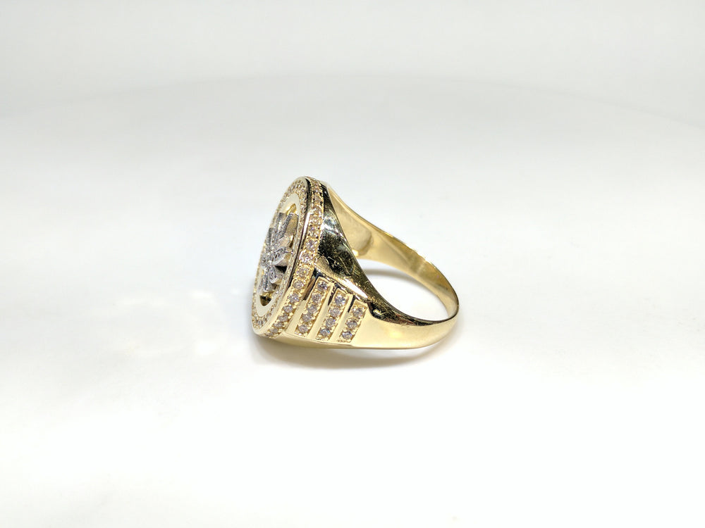 Side view of a 10 karat yellow gold signet ring with a white marijuana leaf embedded inside a bezel iced out with cubic zirconia - Popular Jewelry New York