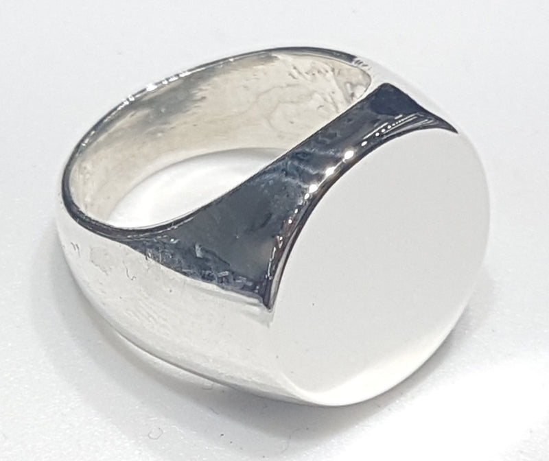products/signet_ring_sterling_silver_candid.jpg