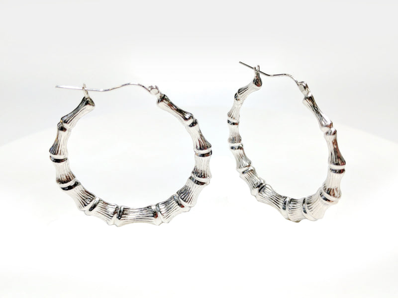 products/sterling_silver_925_bamboo_style_hoop_earrings_standing_multiple_angle_view_Popular_Jewelry_1600x_393b8585-7c52-4520-9d13-5a8b02c55bc6.jpg