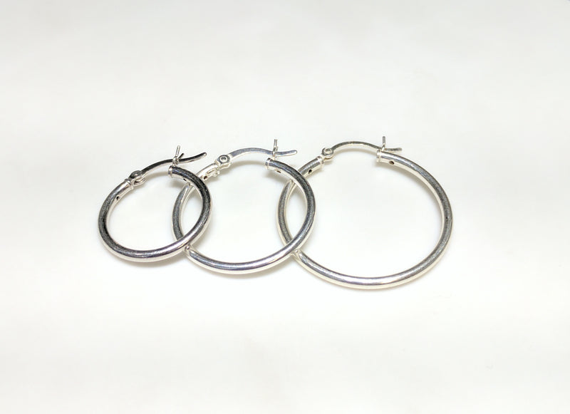 From left to right: three different individual smaller sized sterling silver earrings arranged from smallest to largest - Popular Jewelry