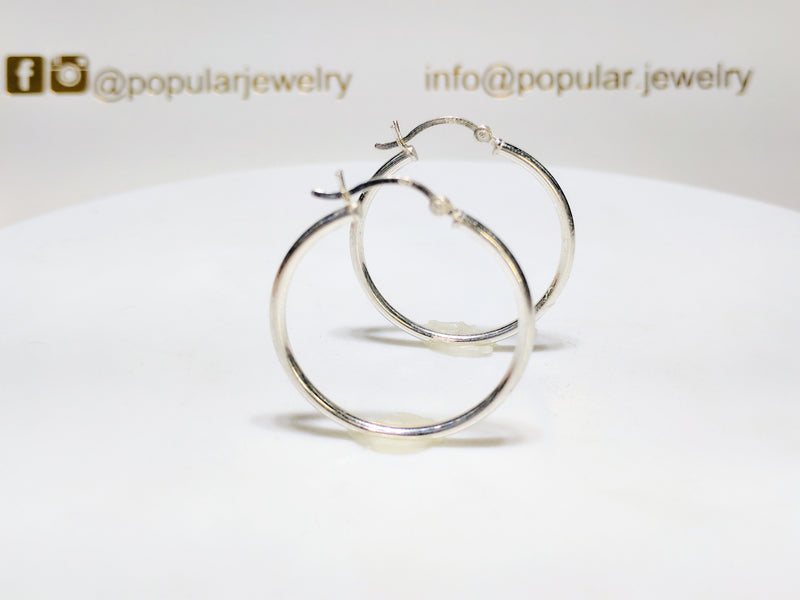 A pair of sterling silver plain high polished finish hoop earrings standing - Popular Jewelry