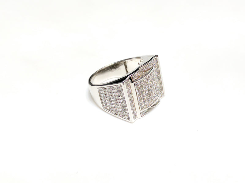 In the center: white sterling silver men's rings set with cubic zirconia in a micro pave setting laying flatangle view made by Popular Jewelry in New York City