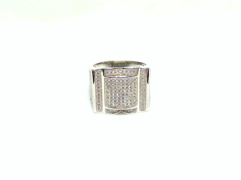 In the center: white sterling silver men's rings set with cubic zirconia in a micro pave setting laying down viewer made by Popular Jewelry in New York City