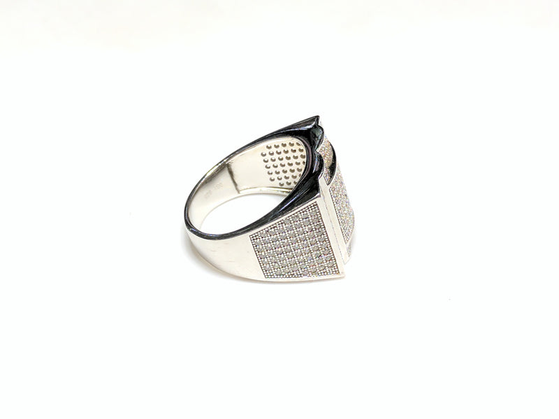 In the center: white sterling silver men's rings set with cubic zirconia in a micro pave setting laying flat side view made by Popular Jewelry in New York City