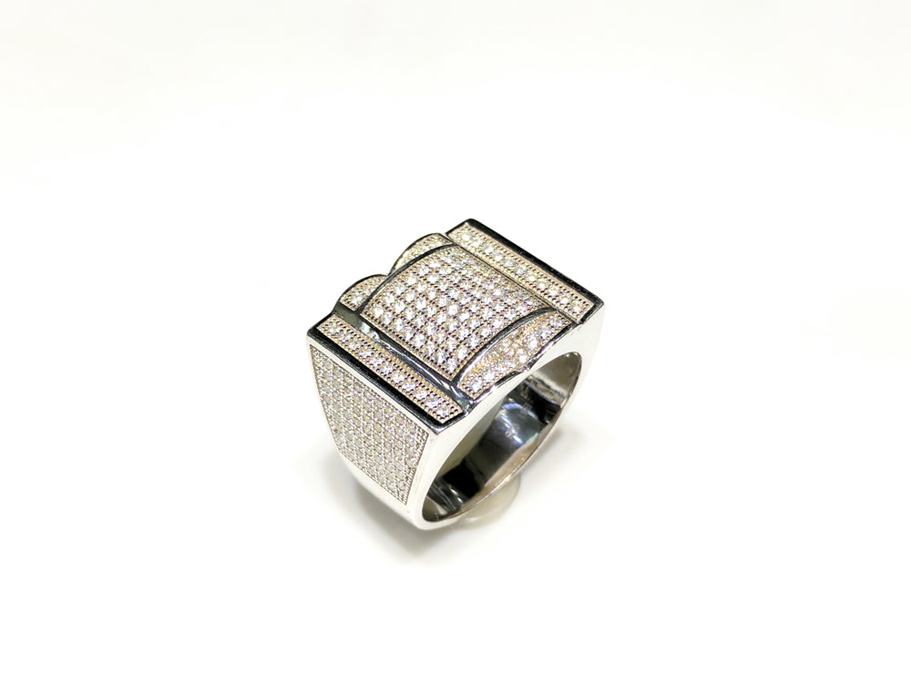 In the center: white sterling silver men's rings set with cubic zirconia in a micro pave setting standing up at angle view made by Popular Jewelry in New York City