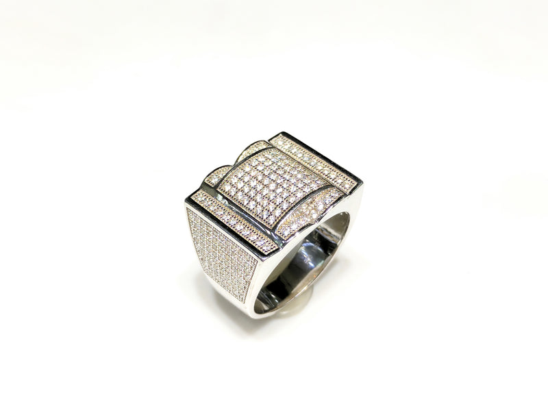 In the center: white sterling silver men's rings set with cubic zirconia in a micro pave setting standing upangle view made by Popular Jewelry in New York City