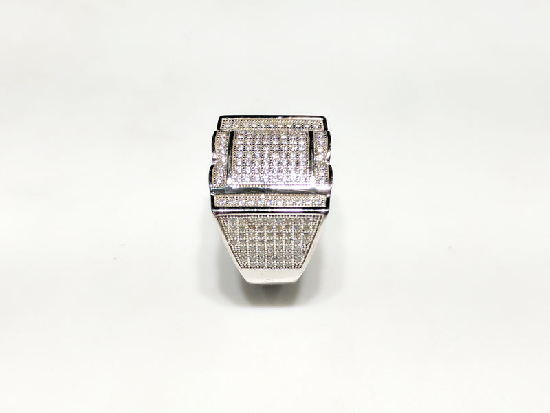 In the center: white sterling silver men's rings set with cubic zirconia in a micro pave setting standing up side view made by Popular Jewelry in New York City