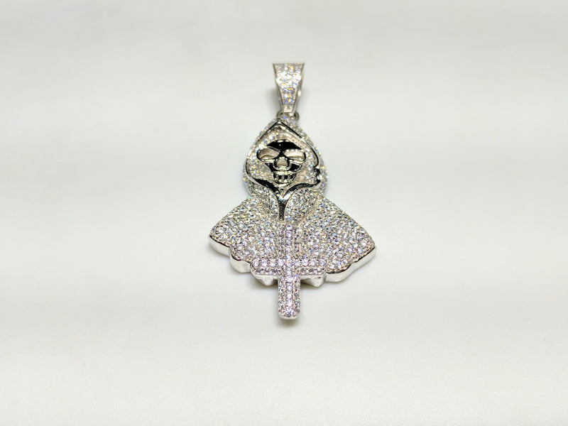 In the center: a white sterling silver hooded skeleton iced out with cubic zirconia in a beautiful micro pave setting made by Popular Jewelry in New York City