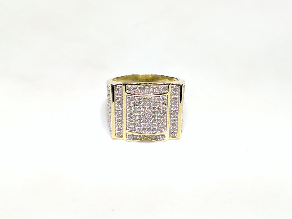 In the center: yellow sterling silver men's rings set with cubic zirconia in a micro pave setting laying down viewer made by Popular Jewelry in New York City