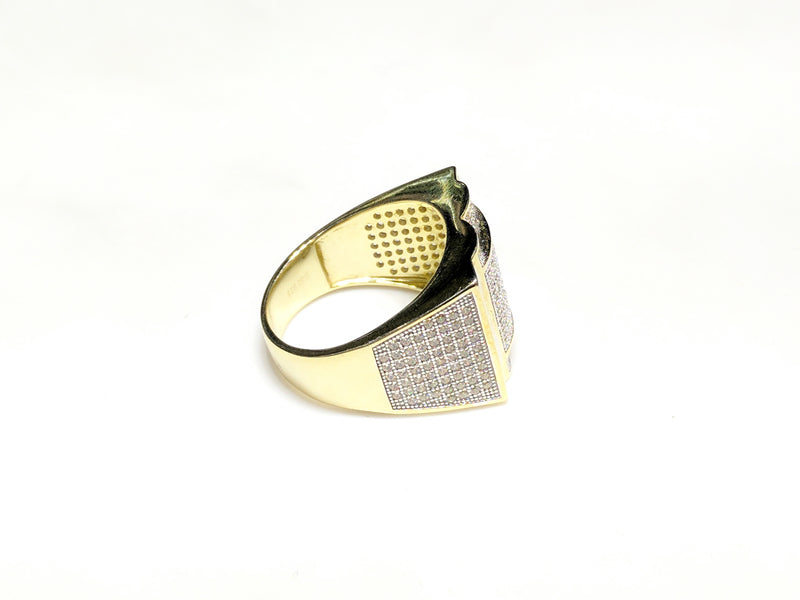 In the center: yellow sterling silver men's rings set with cubic zirconia in a micro pave setting laying flat side view made by Popular Jewelry in New York City