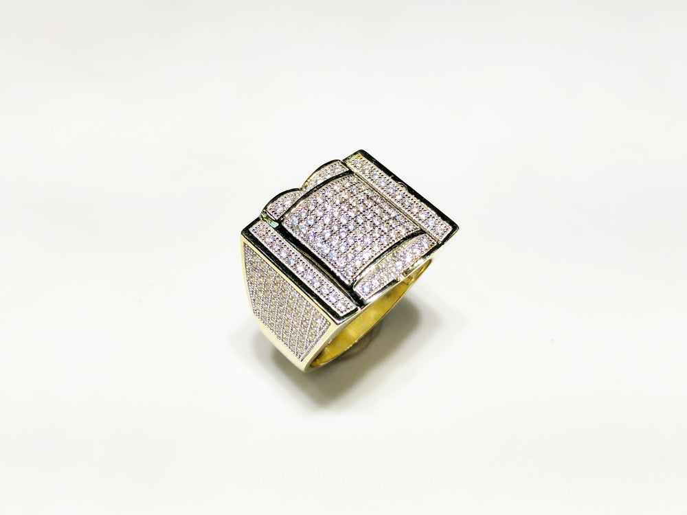 In the center: yellow sterling silver men's rings set with cubic zirconia in a micro pave setting standing up at angle view made by Popular Jewelry in New York City