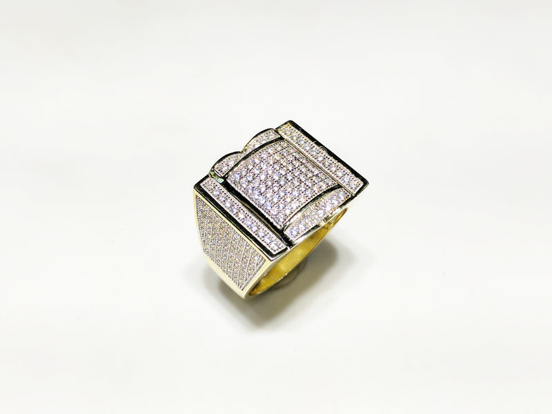 In the center: yellow sterling silver men's rings set with cubic zirconia in a micro pave setting standing upangle view made by Popular Jewelry in New York City