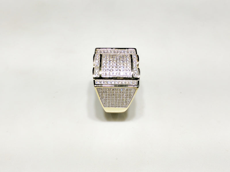 In the center: yellow sterling silver men's rings set with cubic zirconia in a micro pave setting standing up side view made by Popular Jewelry in New York City