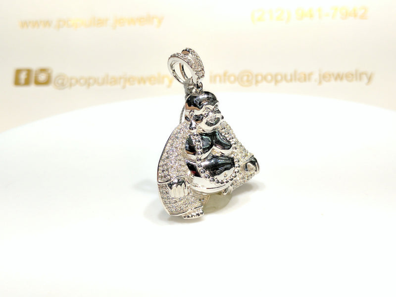 In the center: a sterling silver Seated Laughing Buddha Pendant iced out with cubic zirconia set in micropave style facing 45 degrees made by Popular Jewelry in New York City