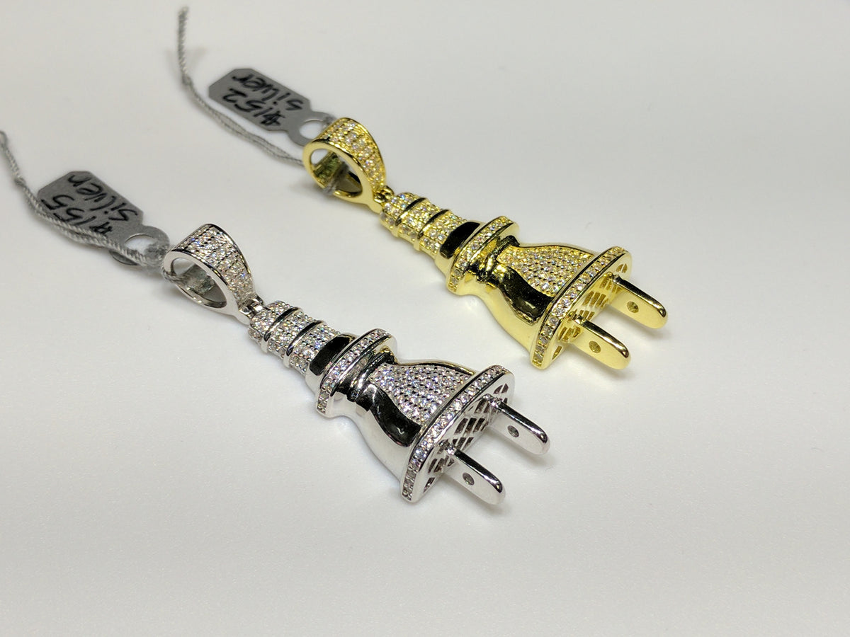 0794bd120 From left to right: two white and yellow colored sterling silver electrical  plug pendants with