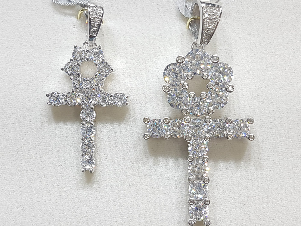 Two sterling silver ankh pendants side by side set with cubic zirconia in direct view - Popular Jewelry