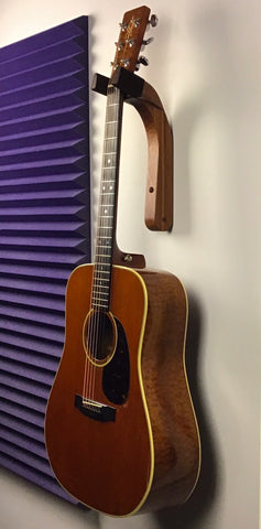 guitar on special sapele wood wall mount holder full view