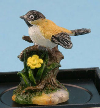Black capped Chickadee with daffodils statuette by Jeannetta Kendall