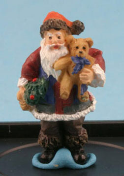 Santa with Teddy bear by Jeannetta Kendall