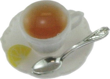 CUP OF HOT TEA W/LEMON ON SAUCER W/SPOON