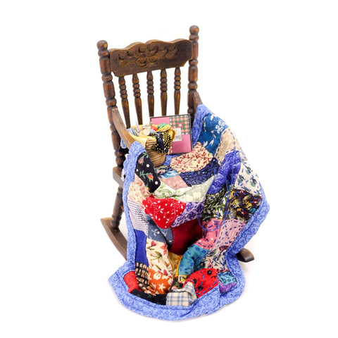 Rocking Chair with Quilt
