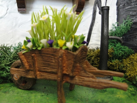 Wheel Barrow with White Daisies