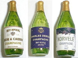 Set of Three Champagne Bottles