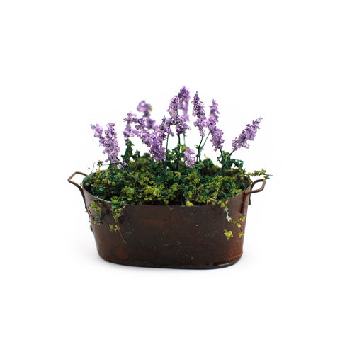 Rustic Copper Planter with Purple Flowers