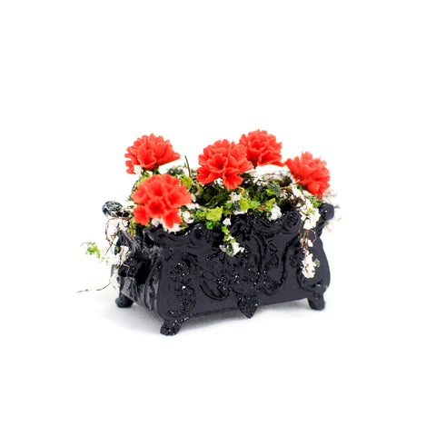 Black Planter with Red Geraniums