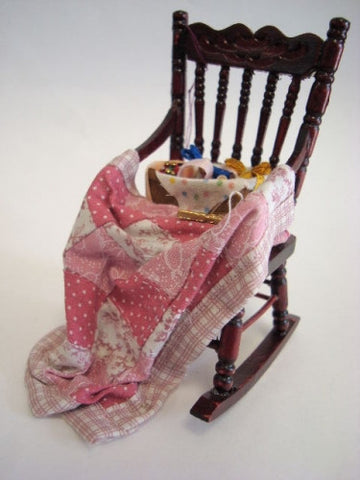 Rocking Chair with Pink Quilt