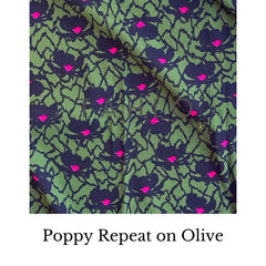 Poppy repeat on olive green fabric swatch