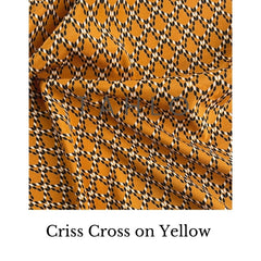 small print on yellow fabric swatch